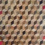 <b>Pink Tumbling Blocks</b>  |  recycled rulers  |  102 x 121cm