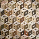 <b>Adjacent Hollow Cubes</b>     recycled rulers     103 x 129cm